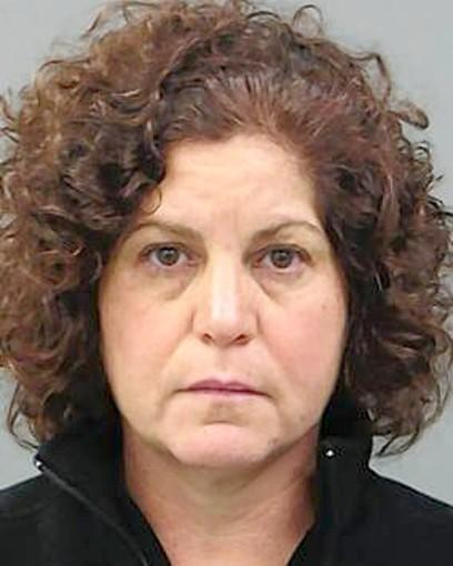 "<b><big>The former fine arts chairwoman for Barrington High School has been charged with felony theft after being accused of stealing more than $5,000 in theater and raffle ticket proceeds from the school's March production of ""Hello, Dolly!"" police said.</big></b><br><a href=""http://www.chicagotribune.com/news/local/suburbs/barrington_area/ct-met-barrington-ex-teacher-arrested-20121115,0,440679.story""target=""_blank"">Read the full story>></a>"