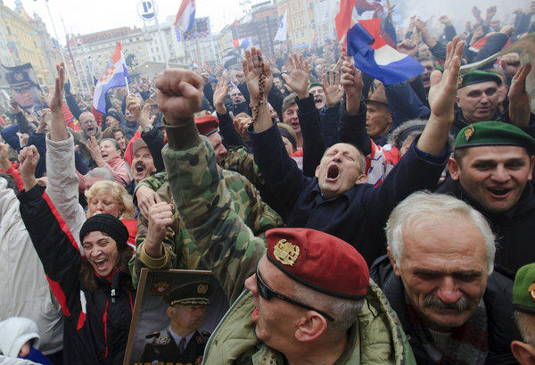 Croatian war veterans celebrate in central Zagreb after a live broadcast from The Hague showed the Yugoslav war crimes tribunal's decision to reverse two Croatian generals' convictions for atrocities during a 1995 offensive against Serbs.