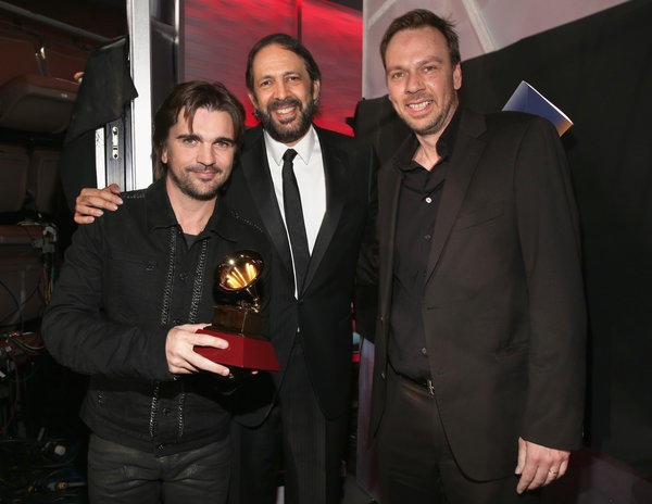 Juanes, Juan Luis Guerra, and Gustavo Borne at the Latin Grammy Awards at the Mandalay Bay Events Center in Las Vegas on Thursday.