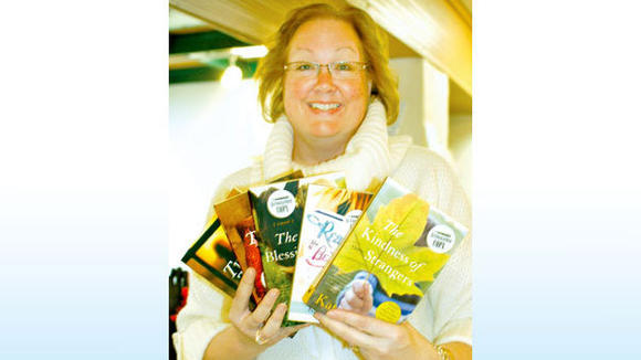 Jill Miner displays the five books written by Katrina Kittle, all available at Saturn Booksellers. Upon discovering Kittle¿s books, Miner shared her enthusiasm for them with her Gaylord customers.