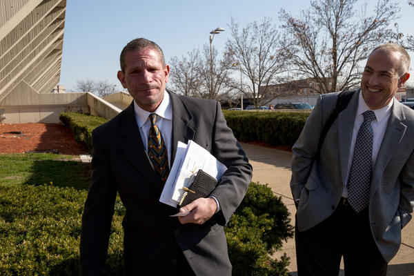 Drew Peterson attorneys David Peilet, left, and Steve Greenberg leave Will County Courthouse.