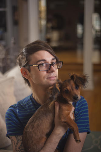 Christian Siriano holds his dog Bear.