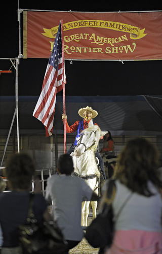 People watch the Great American Frontier Show on opening night of the Broward County Fair, Thursday, November 15, 2012.