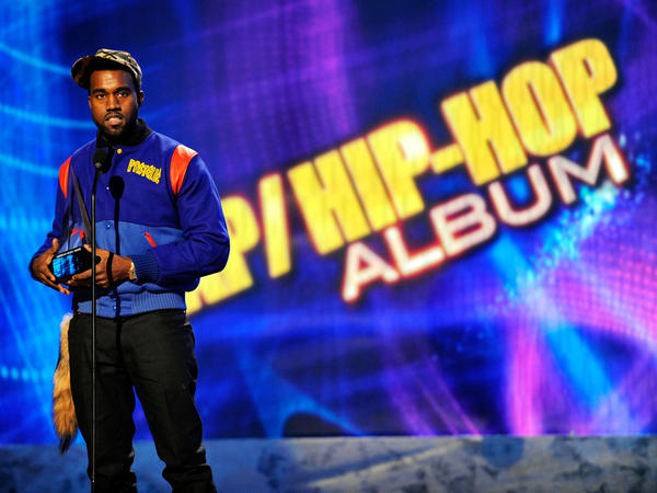 Kanye West accepts his award for rap/hip-hop album at the 2008 American Music Awards.