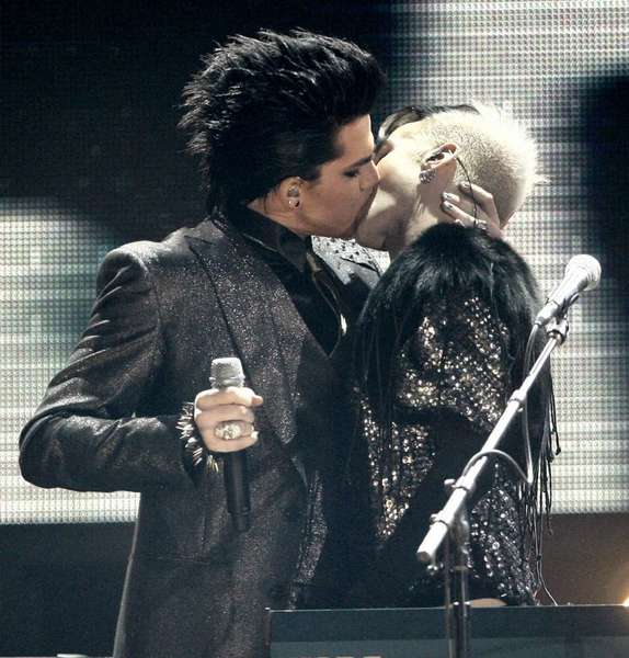 In one of the most controversial performances the show has seen Adam Lambert, left, kisses one of the dancers as he performs during the closing act of the 37th Annual American Music Awards on Sunday, Nov. 22, 2009, in Los Angeles.