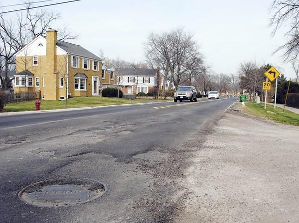 """Cook County recently resurfaced a portion of Happ Road, between Winnetka and Willow roads, in Northfield that village officials later deemed """"unacceptable."""""""