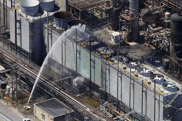 Firefighters finish battling a blaze at a Chevron refinery in Richmond, Calif., in August.