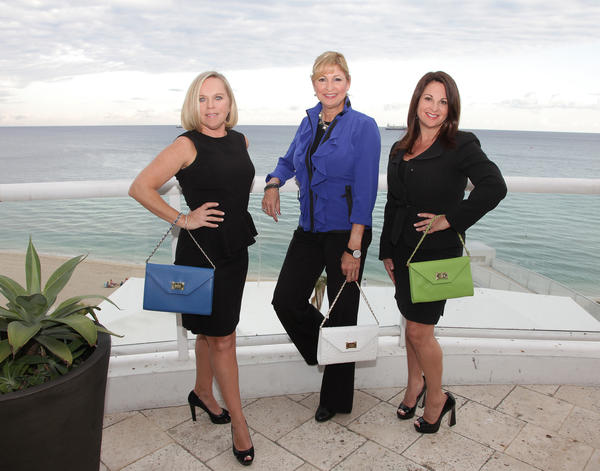 "Tammy Kennedy, left, Anita Lamberti and Nanci Simonson put their best purse forward while promoting the Multiple Sclerosis (MS) Foundation's ""Fashion Fights MS,"" which will take place Dec. 13 at the Ritz-Carlton Fort Lauderdale."