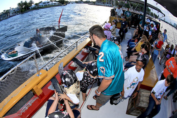 Miami Dolphins player Brandon Fields with students on a pirate ship. In addition to Fields, Dolphins players Dan Carpenter, John Denney, Nate Garner, Marlon Moore, cheerleaders, T.D. and members of the Miami Dolphins Women's Organization recently took students that have parents in the military on a trip to Bluefoot Pirate Adventures in Fort Lauderdale.