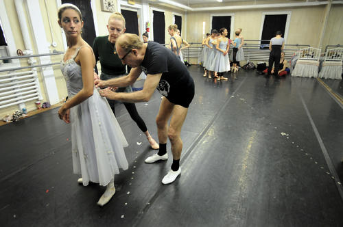 Joseph Albano, founder and artistic director, and Julia Frederick, associate director, help dancer Amanda Fredette adjust her costume before rehearsing the Land of the Snow at Albano's West End studio.