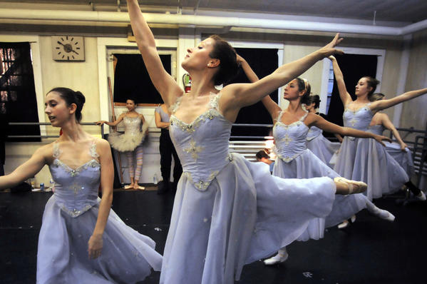 Jessica Higgins, (center) of New York City, rehearses the Land of the Snow.