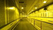 Both tubes of the Brooklyn Battery Tunnel reopened Monday morning in another step in the region's recovery from Sandy.