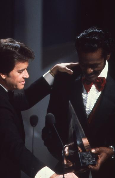 Dick Clark presents Chuck Berry the American Music Award of Merit at the 1981 telecast.