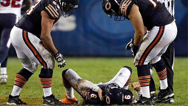 Chicago Bears quarterback Jay Cutler (6) lies on the field after being hit late on a play by the Houston Texans with his teammates over him during the first half of their NFL football game at Soldier Field in Chicago, November 11, 2012. Cutler didn't play in the second half.