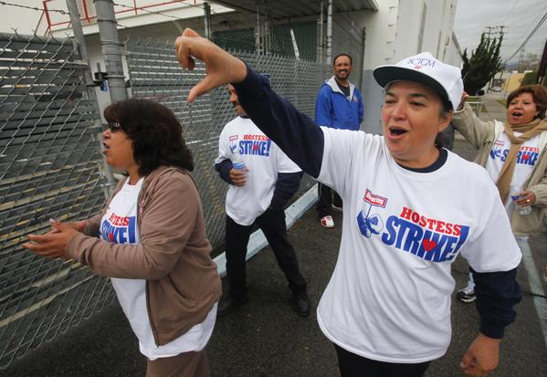 Elvira Delgado, foreground right, leads fellow striking bakery workers on the picket line at the Hostess Bakery in Los Angeles.
