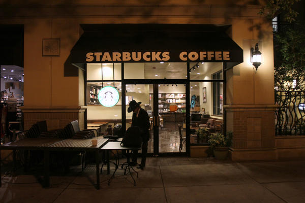 Ray Forthuber, 54, packs up his laptop in front of Starbucks Coffee on Park Ave., where he spends most of his time, in Winter Park, Fla. Wednesday, October 11, 2012.  Ray and his wife Sally Forthuber, 69, are homeless.  They live out of their car along Park Ave.