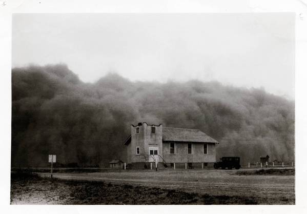The huge Black Sunday storm -- the worst storm of the decade-long Dust Bowl in the southern Plains -- just before it engulfed the Church of God in Ulysses, Kansas, April 14, 1935.