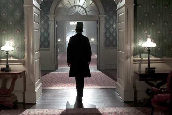 "Abraham Lincoln, played by Daniel Day-Lewis, walks through the corridors of the White House in this scene from director Steven Spielberg's drama ""Lincoln."""