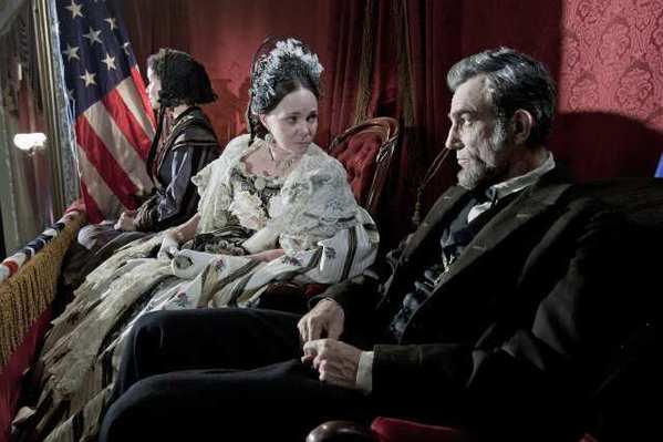 "Gloria Reuben as ""Elizabeth Keckley,"" Sally Field as ""Mary Todd Lincoln"" and Daniel Day-Lewis as ""Abraham Lincoln"" appear in this scene from director Steven Spielberg's drama ""Lincoln."""