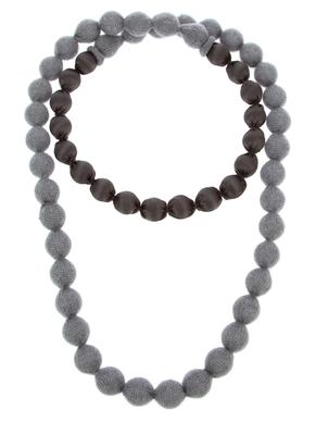 The Liska cashmere and silk beaded necklace ($169.93) from Farfetch.com is a rich statement piece to pair with a colored Oxford shirt or boat neck sweater.