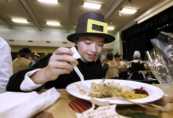 Fifth grader Jason Suh enjoys a Thanksgiving meal during lunch at La Canada Elementary School in La Canada on Friday, Nov. 16, 2012.  The annual event has the 5th grade classes dress up in costumes and are served the meal by volunteer parents.