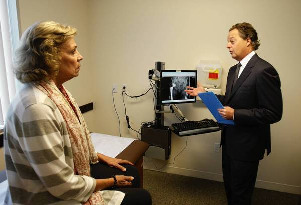 Dr. James Caillouette of the Hoag Orthopedic Institute in Irvine discusses a hip replacement procedure with Mary Anne Ramey of San Diego.