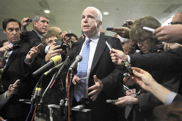 Sen. John McCain (R-Ariz.) speaks to the media after a hearing on the Benghazi attack before the Select Committee on Intelligence.