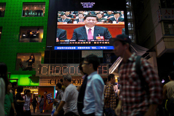 A monitor in a Hong Kong shopping district shows a news broadcast of Xi Jinping, new general secretary of the Communist Party of China.