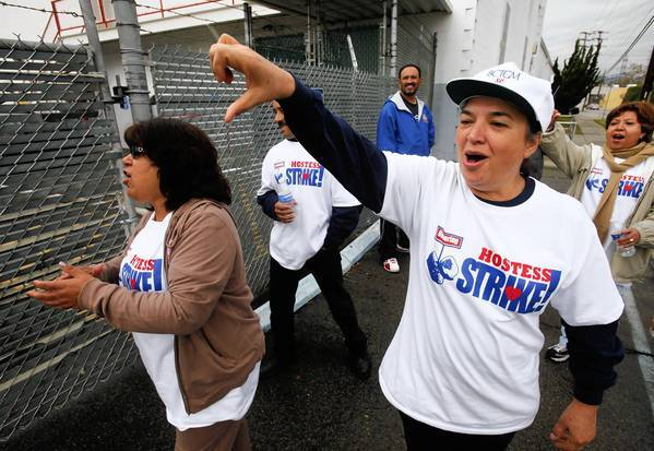 Elvira Delgado, right, leads her fellow striking bakery workers on the picket line at the Hostess Bakery in Los Angeles. Hostess has asked a bankruptcy judge for permission to go out of business and lay off 18,500 workers, blaming the strike by members of the Bakery, Confectionary, Tobacco Workers and Grain Millers International Union.