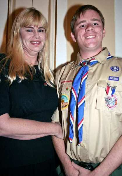 Proud mom Melanie Senneff accompanies her son Eagle Scout Ryan Senneff, 18, who represents the Rose Parade Tournament Troop 91.