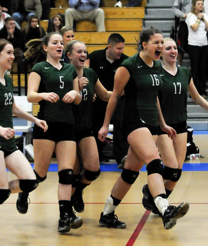 The Coventry bench led by Katie Riddell (16) celebrate their win over Holy Cross in the Class S girls volleyball championship Friday night at Glastonbury High School.