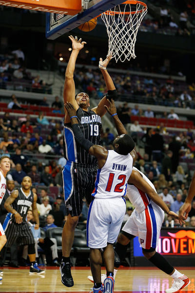 Gustavo Ayon #19 of the Orlando Magic shoots over Will Bynum #12 of the Detroit Pistons at the Palace of Auburn Hills on November 16, 2012 in Auburn Hills, Michigan.
