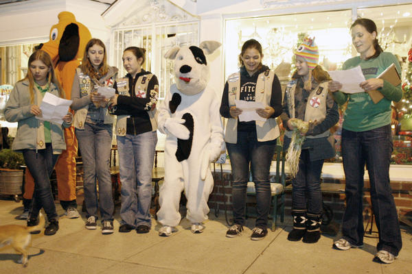 Girls Scout Troop #6822 members sing Christmas carols for C.R.O.P.S, an organization that promotes pet adoption from shelters, during the Holiday in the Park event, which took place near Magnolia Blvd. and Hollywood Way in Burbank on Friday, November 16 2012.