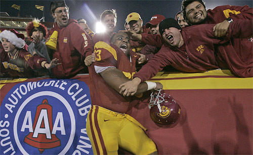 USC defensive end Everson Griffen celebrates with fans.