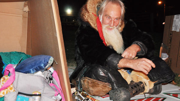 Daniel Boden, Somerset, warms up next to a camp fire during the 2012 Somerset County Cardboard City sleep out.