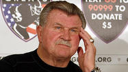 "Former Bears coach and Hall of Fame tight end Mike Ditka was hospitalized Friday after suffering what he said doctors told him was a ""very minor stroke."""