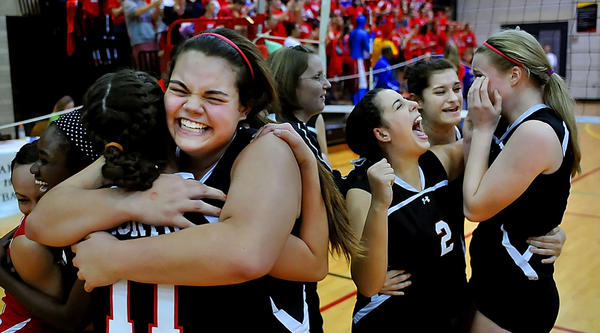 North Hagerstown's Zoe Schreiber and Sarah Bentley, left, and Lauren Serafini, Jessica Wivell and Peyton Wallech celebrate after beating Centennial in the Maryland Class 3A volleyball final Friday at the University of Maryland.