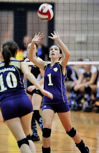 Smithsburg's Payton Bellea sets a pass to teammate Emily Seward (10) during Set 1 of the Leopards' sweep of Perryville on Friday en route to the school's fourth consecutive Maryland Class 1A title at College Park, Md.