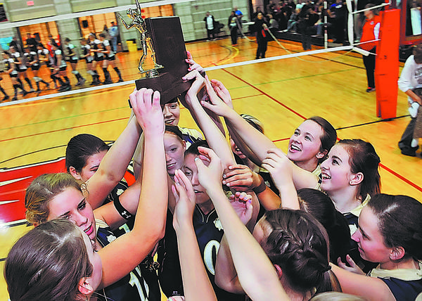 The Smithsburg volleyball team lifts the school's fourth straight state championship trophy after defeating Perryville for the Maryland Class 1A title.