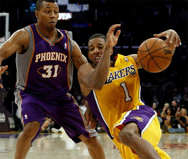 Darius Morris slips as he attempts to drive to the basket against Suns guard Sebastian Telfair.