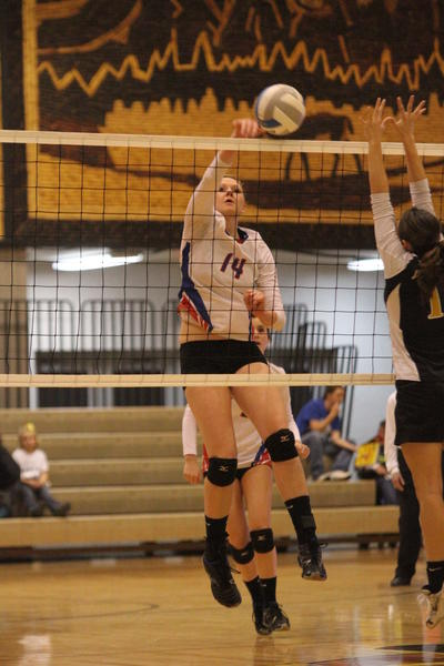 Rachel Rogers of Warner goes for a kill in Fridays seminal match against James Valley Christian. Mitchell Daily Republic Photo by Luke Hagen