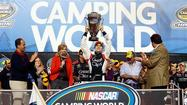 James Buescher won NASCAR's Truck Series championship by avoiding trouble in the season finale Friday night.