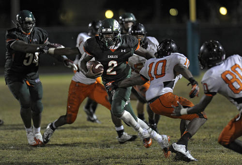Atlantic quarterback Thomas Owens finds room to run against the Boyd Anderson defense during the second half of their game.