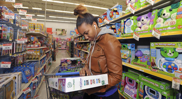 Ebony Harris, Brooklyn Park, looks for a tablet device in a toys aisle of the Walmart in Glen Burnie. She is shopping for toys for her two children.