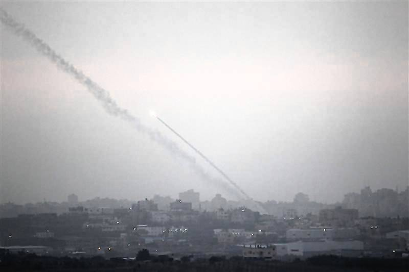 Smoke trails are seen as a rocket is launched from the northern Gaza Strip towards Israel. Palestinian militants fired a rocket at Tel Aviv on Saturday but it was intercepted in mid-air by a newly deployed Israeli anti-missile battery and caused no casualties or damage, police said.