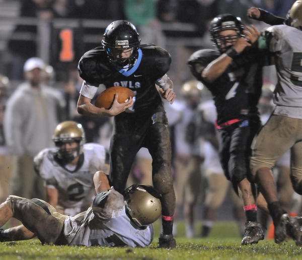 In a photo from earlier this season, Westminster quarterback Deryk Kern gains yardage against Century High. In Friday's playoff win against Sherwood, Kern threw for six touchdowns and ran for three more scores.