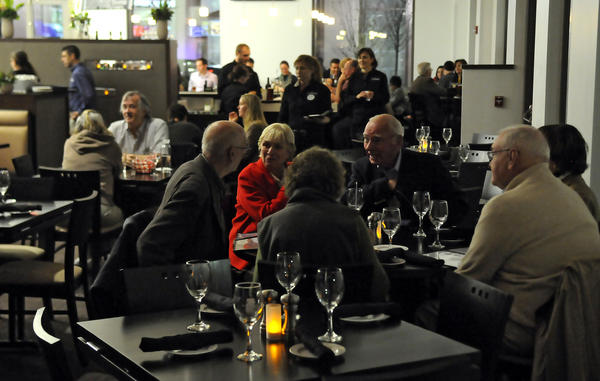 Diners can enjoy a cocktail, appetizer or meal before seeing a movie at the new Spotlight Theater in downtown Hartford, which opened Friday.