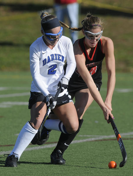 Darien's Kat Huber, 2,  battles Cheshire's Michelle Federico, 44, during the second half. The state high school field hockey championships took place Saturday at Cottone Field at Wethersfied High School in Wethersfield.