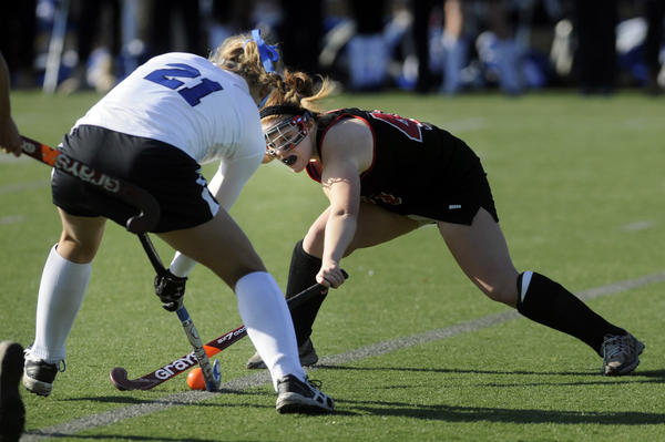 Darien's Erika Osherow, 21, battles Cheshire's Kathleen Lima, 40,  during the second half. The state high school field hockey championships took place Saturday at Cottone Field at Wethersfied High School in Wethersfield.