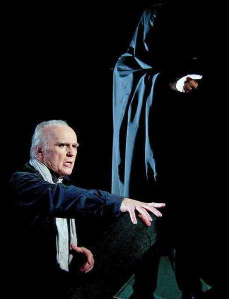 "David Allen Jones as ""Scrooge"" and Frank Simons as the ""Ghost of Christmas Yet to Come"" in the Grove Theater Center production of ""A Christmas Carol."""